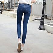 firmar la versión coreana de los pantalones vaqueros de cintura dobladillo de hendidura irregular pies femeninos estiramiento medias de