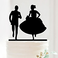 The Bride and Groom Chasing Cake Topper