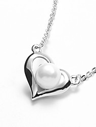 Faddish Shell Pearl with Platinum Plated Heart Frame Pendant Necklace and Stud Earrings Set