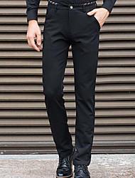 Masculino Solto Jeans Calças-Cor Única Casual Simples Jacquard Cintura Média Zíper Algodão Micro-Elástico Outono / Inverno