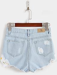 Spot Sommer neuen, frischen und eleganten gestickten Blumen kleinen ausgefransten Jeans-Shorts schließt weibliche College Wind