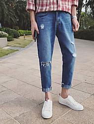 Hommes&# 39; 2017 trou de ressort dans les pieds collants du genou coréen jeans mince marée Harlan complexe neuf points