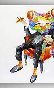 油絵の印象延伸ハングアップする準備ができて枠とカエルの手塗りのキャンバス